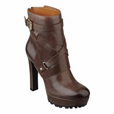 "Street chic platform bootie.  Back zipper closure.  Leather upper.  Measurements: heel 4 3/4"" and platform 1 1/4"""