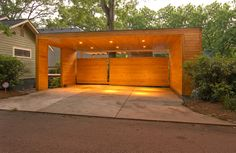Slideshow: 8 Modern Carports | Dwell | The carport outside Todd and Heather Dominey's house in Decatur, Georgia, leaves the vehicles it shelters partially exposed to the elements but encourages a southeast breeze to flow through, keeping the spaces cool.    This originally appeared in Dominey Pavilion and Carport.