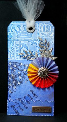 Eileen's Crafty Zone: PanPastel Tag with A Tim Holtz Embossing folder and a Rosette Die