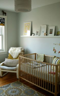 I like the shelf above the cot but also the placement of the chair and the cot. Gives you some privacy when feeding