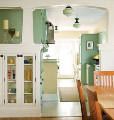love the columns to frame the doorway + built-in bookshelves with glass doors
