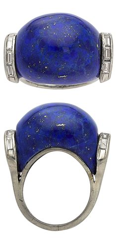 An Art Deco Lapis Lazuli, Diamond, Platinum Ring. The ring features a carved lapis lazuli weighing approximately 26.75 carats. enhanced by baguette-cut diamonds, set in platinum. #ArtDeco #ring