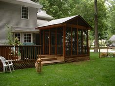 Freestanding screened porch on deck