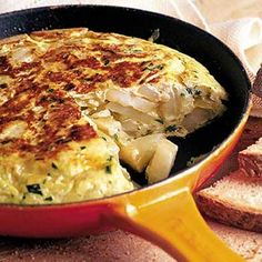 The Best Real Spanish omelette Recipe: new potatoes, onion, extra-virgin olive oil, parsley, eggs