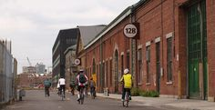 The Brooklyn Navy Yard is closing out summer with a bucketload of events. A sunset bike tour will show off the Yard's sustainable features, countertop manufacturer IceStone will welcome. Nyc Bucket List, Industrial Park, Brooklyn, Street View, Yard, Tours, Architecture, Image, Ph