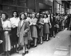 Women dress to impress as they queue to buy ice cream - a luxury item - in London 1945...