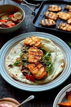 Harissa halloumi, roasted vegetable and houmous flatbreads with spiced sweet potato wedges