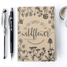 """A little A6 lined notebook with a Boho typographic design inspired by Alice in Wonderland written by Lewis Carroll on the cover.""""Do you suppose she's a wildflower"""
