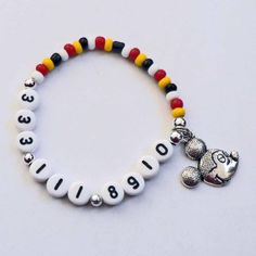 Perfect for kids at Disney parks! Bracelet is Mom/Dad's cell phone number!