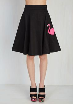 Shake, rattle, and 'stroll' into stellar style by giving this black skirt a spin! A nod to rockabilly fashion, this cotton number's A-line silhouette, midi length, and hot pink flamingo applique are amped to take a twirl with you!