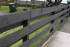 Post and rail stained black.