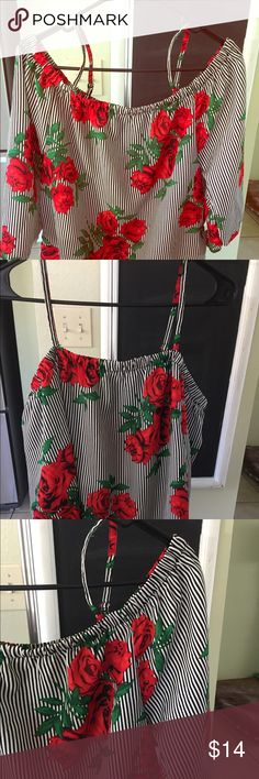 Off the Shoulder Black & White Striped Floral Top Off the shoulder top with straps. Size Large, New Without Tags. Loose fitting, flowing top. Pair with some jeans and black heels👌 Blush Tops Tank Tops