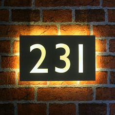 Made to order stainless steel house number plaques in Gill Sans font with back lit LEDs. These are bespoke, high quality products designed and assembled here in the UK.