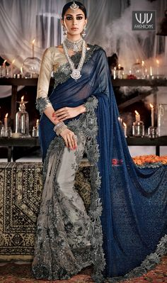 Perfervid Grey Color Net Embroidered Work Designer Saree This brilliant array will make you the ultimate classic beauty at the next event you attend. Women beauty is magnified tenfold in this alluring grey net designer saree. The embroidered and patch border work looks chic and perfect for any occasion