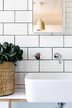 white subway tiles, dark grout + wood | styling work by c+m studio