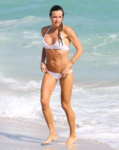 Kelly Bensimon  The Real Housewives alum, 45, flaunted her toned, athletic body in a bikini while hanging out with friends in Miami in December 2013.