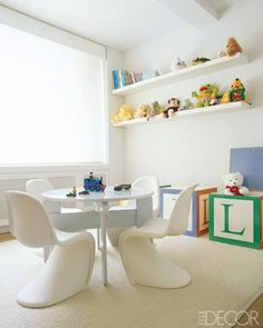 A simple playroom for kids with a table for toys. #kids #children #playroom