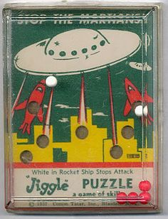 I love vintage hand-held dexterity puzzles . These three space themed versions are some of my favorites. Made in 1957 by Comon Tatar of New. Pocket Game, Retro Robot, Baby Boomer, Flying Saucer, Lost In Space, Old Games, Vintage Ads, Vintage Space, Vintage Ephemera