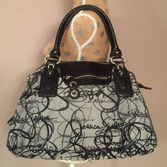 """Jessica Simpson Handbag Black and grey Jessica Simpson Signature Purse. 16"""" across the bottom. 12"""" from top of bag to the bottom. No rips or tears. 2 zipper pockets on each side. Inside has 1 zipper pouch and 2 open pouches. 100% Polyester with 100% PVC Trim. Missing shoulder strap. Very nice. Last pic shows a small ink mark inside. Jessica Simpson Bags"""