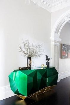 A project by Brendan Wong Design. The green color is the color of balance and harmony. From a color psychology perspective, it is the great balancer of the heart and the emotions, creating equilibrium between the head and the heart.  homedecorideas luxuryhomes consoletables