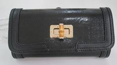 Buy Upcycled Clutch with Bamboo & Black Leather by landfilldzine. Explore more products on http://landfilldzine.etsy.com