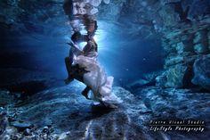 Underwater love. trash the wedding dress underwater photo shoot