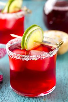 A riff on the tequila classic, Hibiscus Margaritas are easy to make for a crowd!