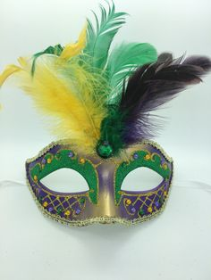 Purple, yellow and green smaller Mardi Gras mask with ribbon ties. Very small.