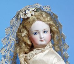 JUMEAU FRENCH BISQUE POUPEE IN BRIDAL COSTUME.  Lot 215