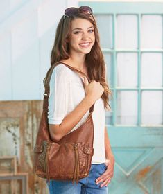 Double Front Zip Leatherette Hobo is a carryall for almost any occasion. With a relaxed, casual vibe, it doubles as a crossbody, as well as an adjustable hobo. It offers fashion and functionality, with plenty of pockets both inside and out to help ke