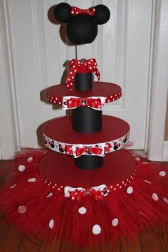 Fabulous Minnie Mouse Cake And Cupcake Stand With Red Tutu And Featuring Black Holder And Minnie Minnie Mouse Baby Shower, Minnie Mouse Theme, Pink Minnie, Decoration Minnie, Birthday Decorations, Pig Decorations, Mickey Party, Mickey Mouse Birthday, Birthday Parties