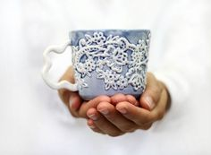 Irisеs blossom over your feet - blue sandal laces! This porcelain mug with a lace pattern will give a romantic touch to your morning breakfast or daily life. Simple, pure, white, modern and dainty cup with elegant double handle which makes comfortable feeling when you hold it in your hands.The lace pattern is hand carved over the raw porcelain and after the decoration is finished the mug is fired two times in the kiln. Used transparent glaze onto it in deep blue water color nuance. Fired…