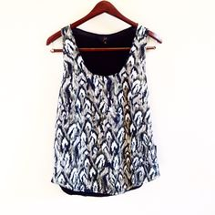 | new | patterned tank offers welcome new with tag size medium lightweight tank with patterned front. from the bb dakota jack collection. •080533•  website: xomandysue.com instagram: xomandysue BB Dakota Tops Tank Tops