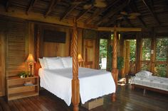 Kanopi House: The wooden tree houses are designed in a breezy West Indies style in Jamaica Wooden Tree House, Tree Houses, Jamaica Hotels, Jamaica Jamaica, Treehouse Living, Bamboo Roof, West Indies Style, Boutique Retreats, Bamboo Architecture