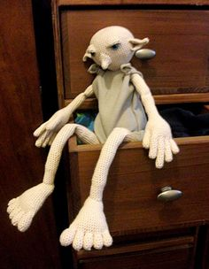 Dobby the house elf! A crochet pattern. #Harry Potter. this is crochet? omg! i love the long legs lol this doll looks pretty cool, he needs one sock though! free dobby!