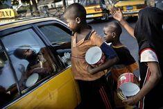 The Talibé of Dakar find them at every corner.