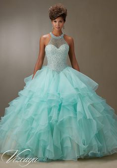 Quinceanera dresses by Vizcaya Ruffled Organza Skirt with Pearl Beaded Bodice Matching Stole included. Colors: Champagne/Blush, Aqua/Champagne, Lilac/Champagne, White.
