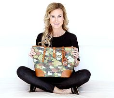 Korie Robertson of Duck Dynasty® on A&E® strikes a pose with the Dooney & Bourke bag she helped design.