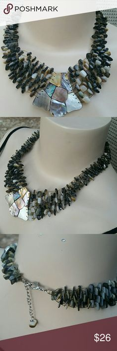 "Mother of Pearl Shell Statement Necklace Gorgeous Bib style statement necklace made from mother of pearl and all natural shells. Perfectly constructed with Tiger wire for sturdy perfection! Colors are shades of browns and blacks with a silver lobster clasp closure and 2 additional inches of adjustment chain. Total length 16"" before chain adjustment. Amazingly beautiful necklace! handmade Jewelry Necklaces"