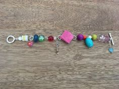 Handmade bracelet of random beads by TinyShopOfStuff on Etsy
