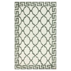 Hand-hooked cotton blend rug in white with a quatrefoil motif and Greek key border.   Product: RugConstruction Materi...