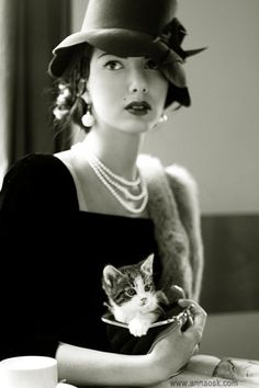 three strands of pearls and a kitty. that's all i need...