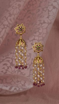 Floral gold earrings handcrafted with vibrant pink and pearl tassels Floral gold earrings handcrafted with vibrant pink and pearl tassels Gold Jhumka Earrings, Jewelry Design Earrings, Gold Earrings Designs, Gold Necklace, Gold Chain Design, Gold Bangles Design, Gold Jewellery Design, Gold Jewelry Simple, Simple Necklace
