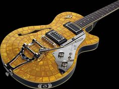Combine the late Tony Zemaitis Uniqe Creativity with German craftmanship and this is what you get: The Duesenberg Starplayer Ron Wood signature, the first limited/signature edition Duesenberg ever Launched. The DRW comes with an elegant circular mother-of-genuine-pearl mosaic top and headstock design complete with Ron's etched signature on the nickel-plated brass pick guard. This is one of the most unique and eye catching guitar designs in decades.