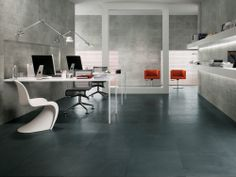 Minoli - Evolution Evolve - Floor Tiles: Evolve Iron 60 x 60 / Wall Tiles: Evolve Silver 30 x 60 cm., Evolve Silver Strutturato 30 x 60 cm.  With these wall tiles and floor tiles, you can play with contemporary colours and extraordinary effects of the surfaces.