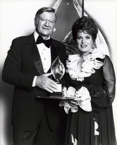 John Wayne and Maureen O'Hara accepting an award for their film McClintock. Description from pinterest.com. I searched for this on bing.com/images