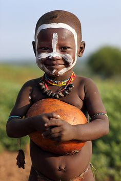 This beautiful child reminds me that... Red and yellow, black and white; they are precious in His sight. (Ethiopian Tribes, Karo)