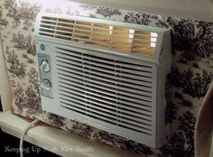 Hmm... There's one idea...   dressing up an ugly window unit, how to, hvac, window treatments, windows