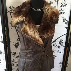 Members Only Faux Fur Beautiful Vest ~ New This Faux Fur Beautiful Vest ~ Vegan Leather Brand New made by ~ Members Only size M ~ fits size 8 - 10 MCM Jackets & Coats Vests