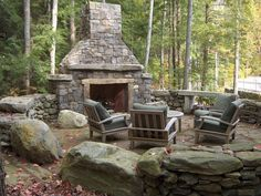 Country Patio with Outdoor seating area, Natural stone retaining wall, stone fireplace, exterior stone floors